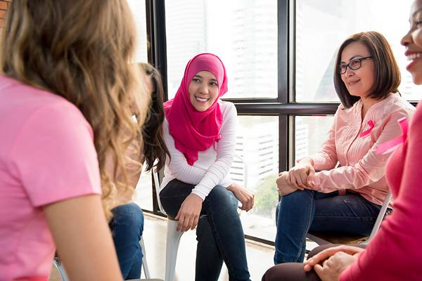 Women chatting in support group